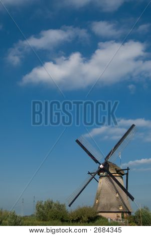Dutch Mill On The Grass