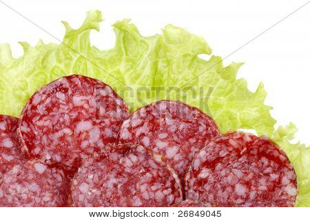 Background from tasty sausages and greens
