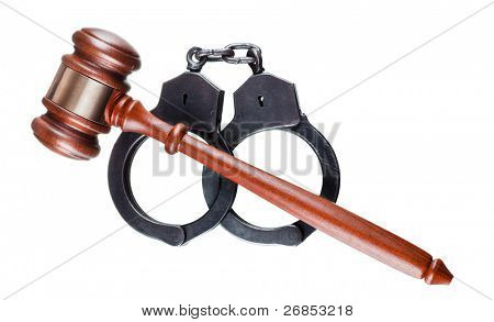 Gavel and handcuffs isolated on white