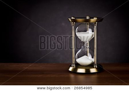 Hourglass on a black background.