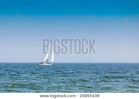 Sailboat on the blue see and sky