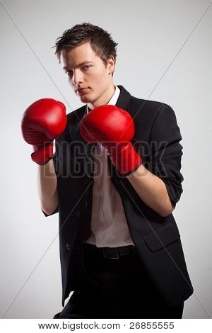 Businessman Wearing Boxing Gloves, On Gray Background