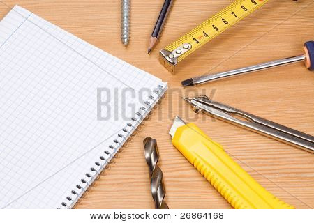 note pad and tools on table