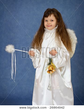 Child Dressed As An Angel With A Magic Wand