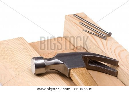 hammer and nail on wood brick isolated on white  background