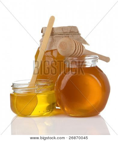 glass pot full of honey and stick isolated on white background