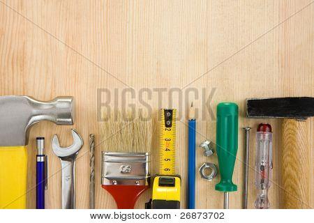 set of tools on wood texture background