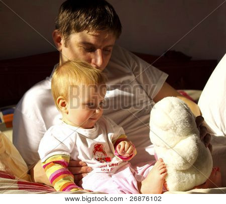 Happy family. Father play with little daughter and white  bear