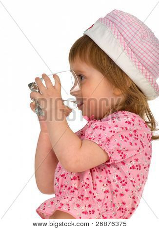 Little girl drink the water. Isolated on white