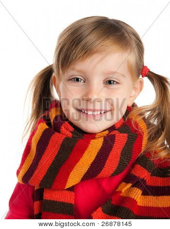 Close-up portrait of a cute little girl in a striped scarf