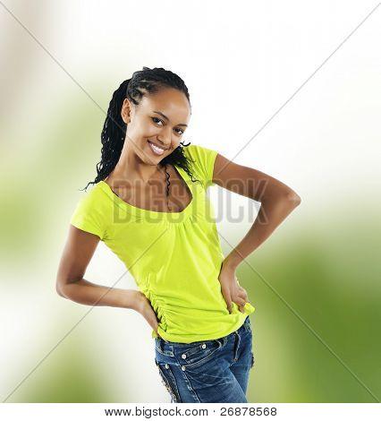 beautiful mulatto girl on green background