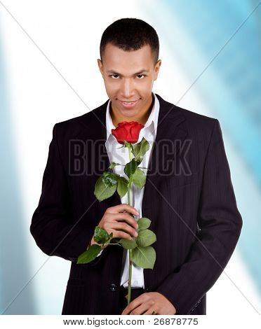 Young men with the red rose on blue background
