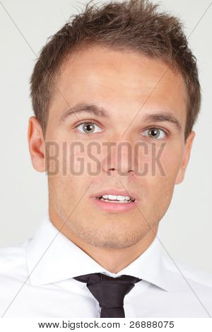 Portrait of afraid looking businessman isolated on white
