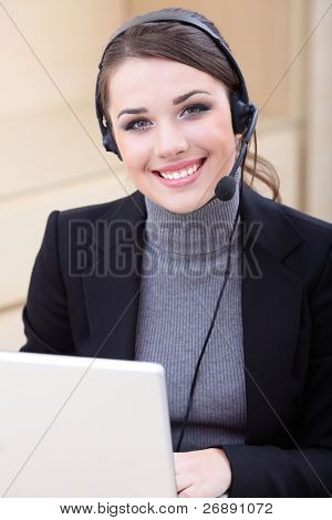 Beautiful call center operator with headset.
