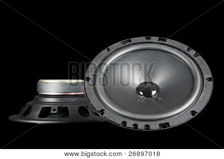 Two Car Speakers Shown From The Front And Side