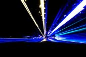 Blurred Background With Cars Light Trails On A Curved Highway At Night. Night Traffic Trails. Motion poster