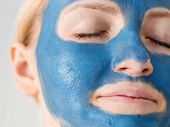 Skin Care. Woman Face With Blue Clay Mud Mask Close Up. Girl Taking Care Of Oily Complexion. Beauty  poster