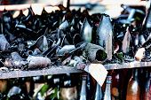 Close Up Damaged Supermarket Glass Plastic Bottles After Arson Fire With Burn Black Dark Debris Afte poster