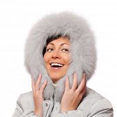 Portrait of smiling woman in fluffy hood poster