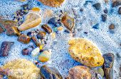 Bubbles In The Water And Smooth Stones Under Your Feet On The Beach To Invoke Serenity. poster