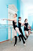 stock photo of ballet barre  - ballet dancers in rehearsal - JPG