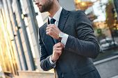 Cropped Profile Portrait Of A Successful Young Bearded Guy In Suit And Glasses. So Stylish And Nerdy poster