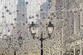 Street Christmas Decoration. White Garlands Above The Street And Vintage Street Lantern poster