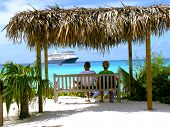 stock photo of couple sitting beach  - an older couple sits on a bench - JPG