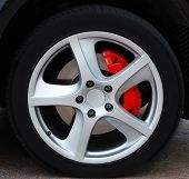 Close up of a car wheel with red brake