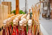 Colored Bottles Of Fragrances With Sticks For The Fragrance Of The House. poster