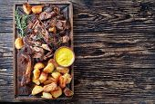 Overhead View Of Delicious Slow Roast Tender Leg Of Lamb Pulled Off The Bones And  Served With Crisp poster