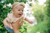 Newborn Baby Enjoy Flying In Fathers Hands. Newborn Baby Girl And Father. I Am Daddys Girl. I Have A poster