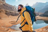 Man Traveler With Backpack Mountaineering .travel Lifestyle Concept Lake And Mountains On Background poster