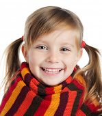 stock photo of cute little girl  - portrait of a cute little girl in a striped scarf - JPG