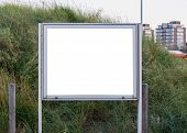 Empty And Blank Metallic Information Board To Put What Ever You Want With A Green Grass Hill In The poster