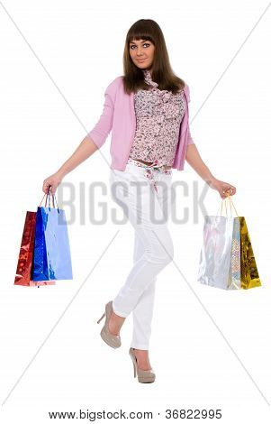 ?heerful Brunette With Purchases Costs On One Foot