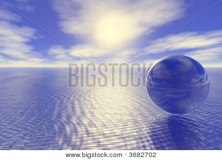 Abstract Glass Globe Over Blue Ocean And Sunset Cloudy Sky