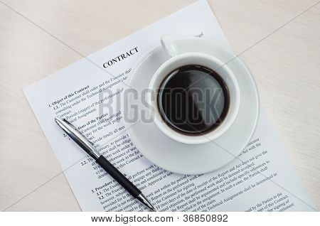 White cup on cotract and wooden table