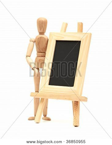 Wooden concept of mannequin in pose with wood frame