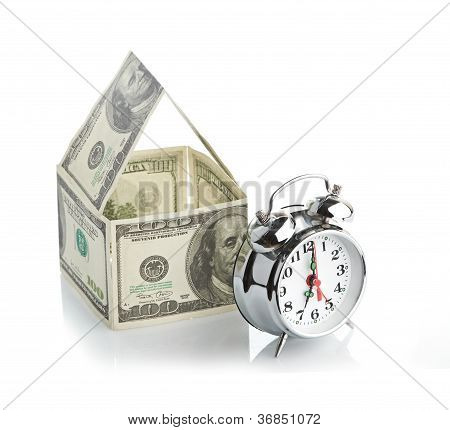 house made of dollars and alarm clock.