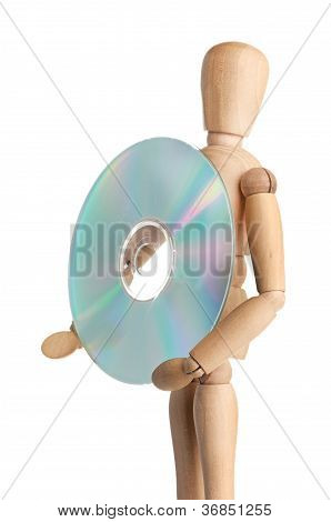 Wooden doll carries data storage media, CD or DVD