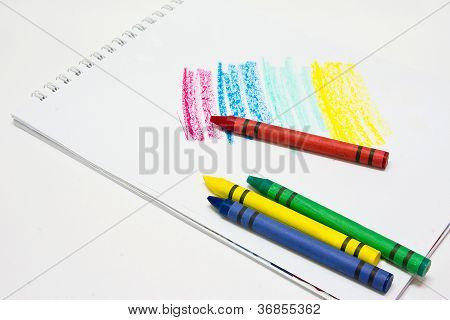 Color crayons on the drawing pad