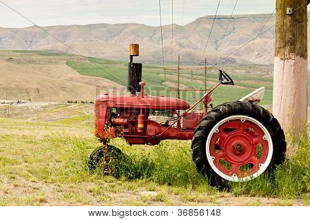 Tractor In Front Of Vista Of Valley