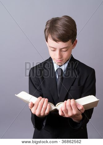 Teen boy reading a book
