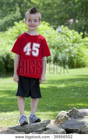 Young Boy On Rocks In The Park
