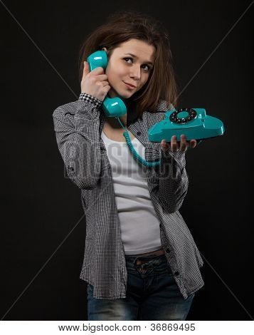 Portrait Of The Funny Girl With Old Phone