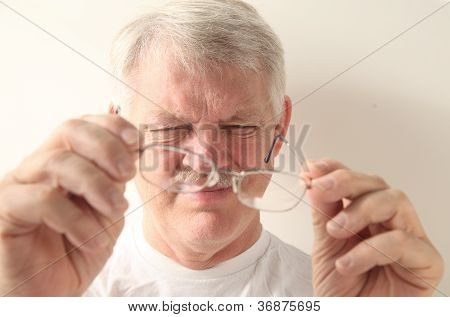 senior man with dirty glasses