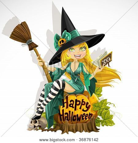 Beautiful young witch with a book and broom sitting on a pumpkin