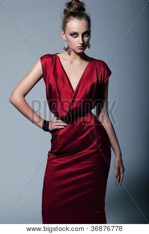 Fashion Model In Contemporary Dress. Studio Shot