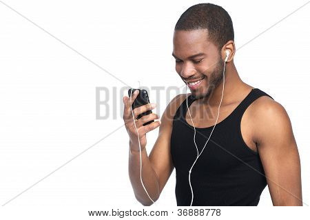 Young Male Listening To Mp3 Player